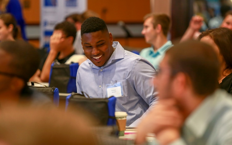 Picture of a Dominion Energy intern at a conference, smiling