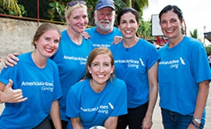 Group of 6 people in blue American Airlines t-shirts