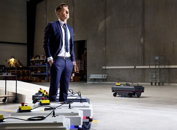 Thomas Visti, MiR CEO, surrounded by the autonomous robots manufactured by Mobile Industrial Robots.