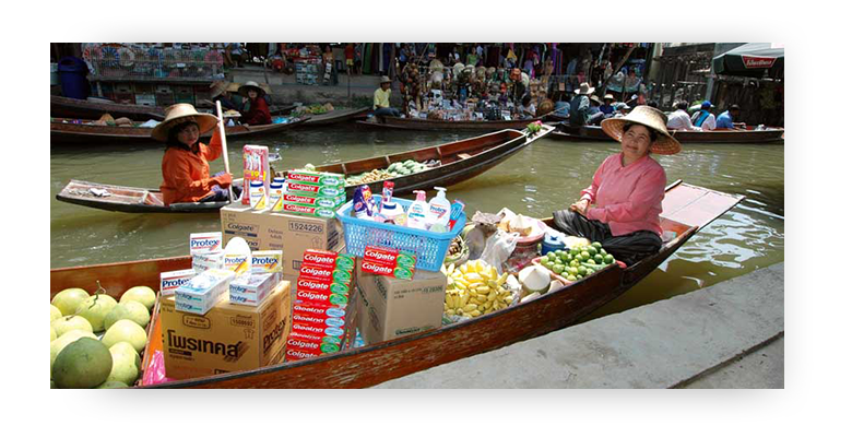 Floating market in Thailand, Asian Woman selling Colgate and Protex from a boat
