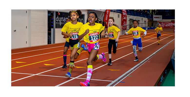 Five elementary age girls running a race during Colgate Womens Games
