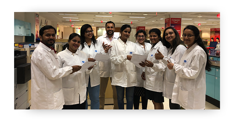 Indian Global Technology Center team of scientists wearing lab coats standing together