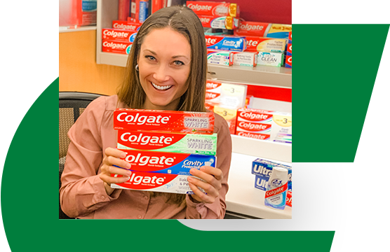 Lindsey Buckheit holding packages of Colgate toothpaste