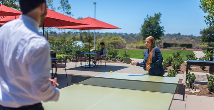 two associates playing ping pong