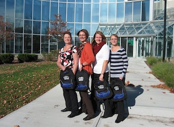 Ladies outside with American National backpacks