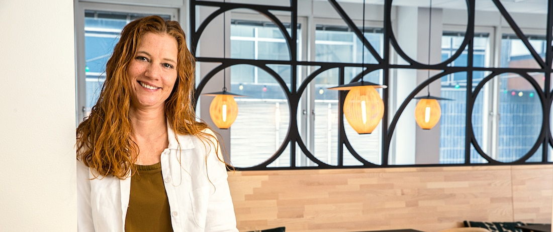 woman stands in offices of Thomas Cook Nordics