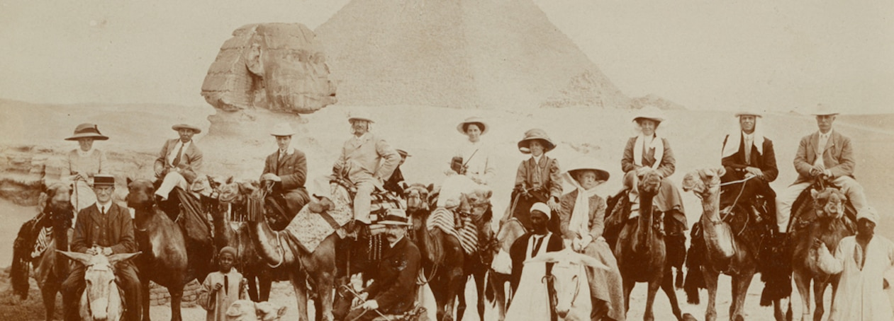 vintage photo of travelers on camels at the Pyramids of Egypt