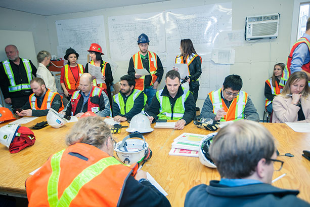 Employees in a team meeting on a Graham project site.