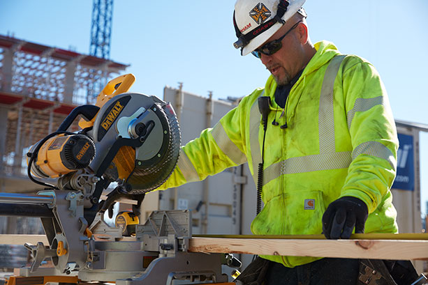 Graham employee using a saw on site.