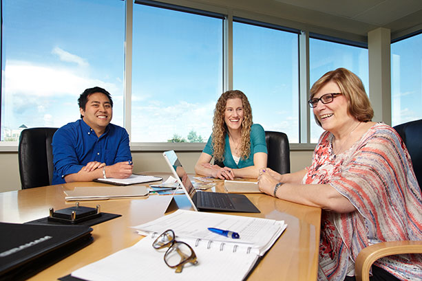 Employees in a team meeting at Graham Corporate Office.